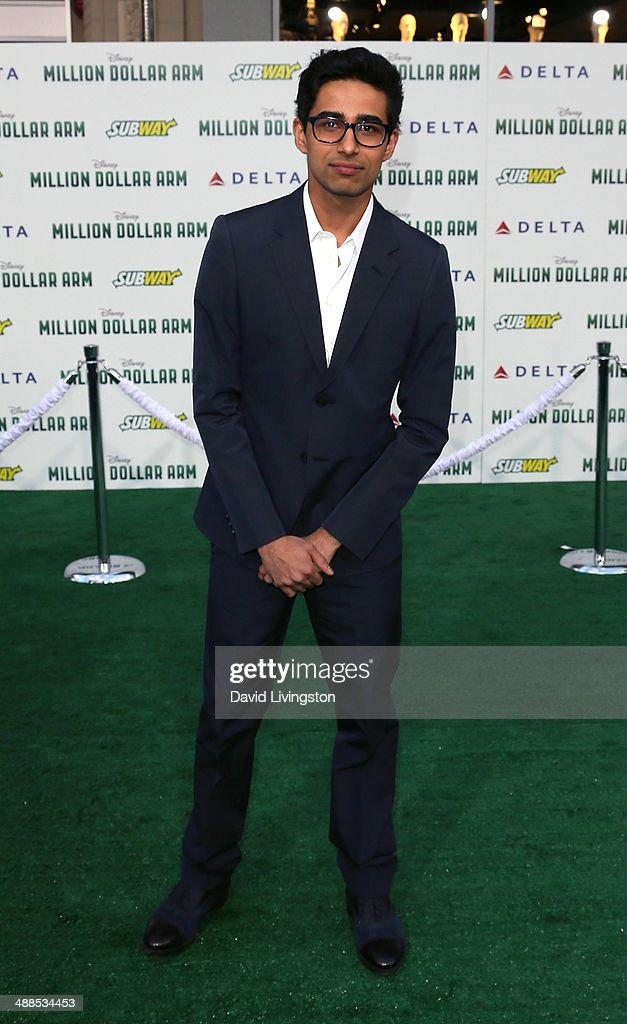 Actor <a gi-track='captionPersonalityLinkClicked' href=/galleries/search?phrase=Suraj+Sharma&family=editorial&specificpeople=9768453 ng-click='$event.stopPropagation()'>Suraj Sharma</a> attends the premiere of Disney's 'Million Dollar Arm' at the El Capitan Theatre on May 6, 2014 in Hollywood, California.