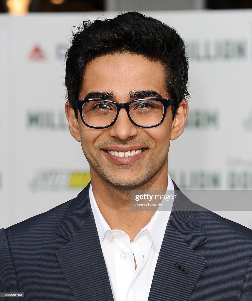 Actor <a gi-track='captionPersonalityLinkClicked' href=/galleries/search?phrase=Suraj+Sharma&family=editorial&specificpeople=9768453 ng-click='$event.stopPropagation()'>Suraj Sharma</a> attends the premiere of 'Million Dollar Arm' at the El Capitan Theatre on May 6, 2014 in Hollywood, California.