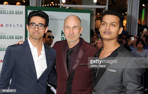 Actor Suraj Sharma director Craig Gillespie and actor Madhur Mittal arrive at the Los Angeles premiere of 'Million Dollar Arm' at the El Capitan...