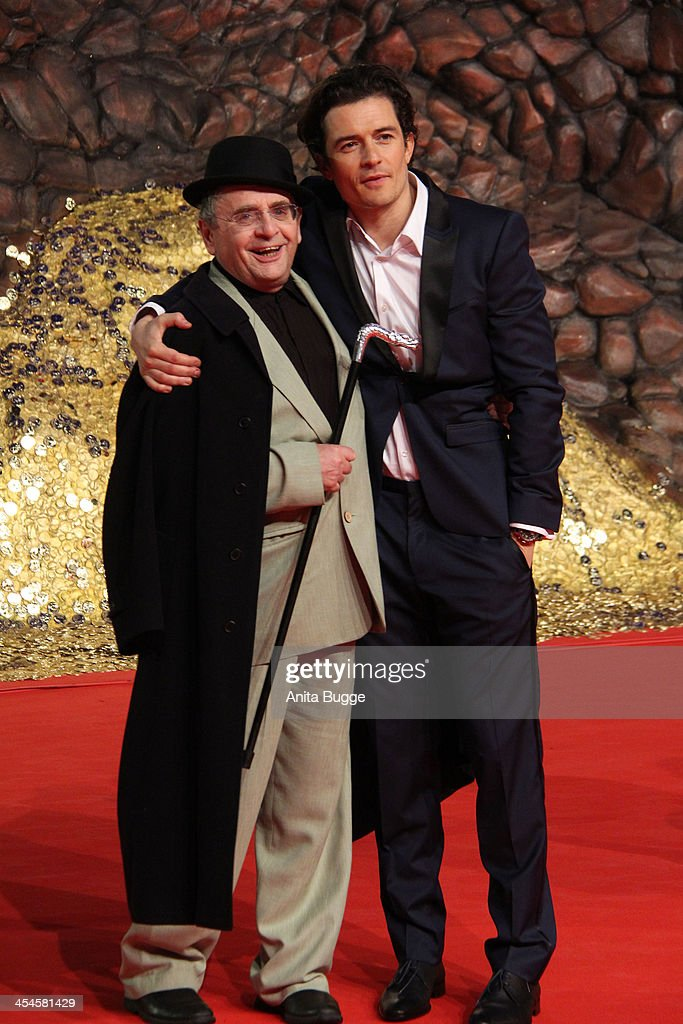 Actor Sylvester McCoy (L) and actor Orlando Bloom attend the 'The Hobbit: The Desolation of Smaug' European Premiere at Cinestar on December 9, 2013 in Berlin, Germany.