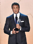 Actor Sylvester Stallone accepts the Best Supporting Actor award for 'Creed' onstage during the 21st Annual Critics' Choice Awards at Barker Hangar...