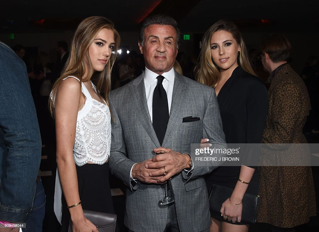 Actor Sylvester Stallone and guests attend the Yves Saint Laurent men's fall line and the first part of its women's collection fashion show at the Paladium, in Hollywood, California, February 10, 2016. / AFP / FREDERIC J BROWN