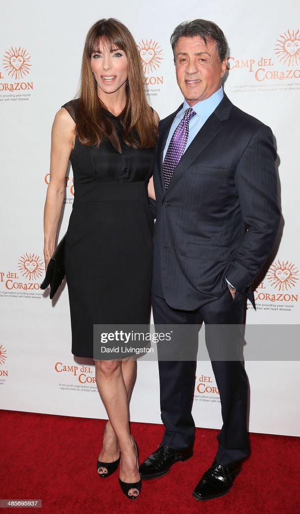 Actor <a gi-track='captionPersonalityLinkClicked' href=/galleries/search?phrase=Sylvester+Stallone&family=editorial&specificpeople=202604 ng-click='$event.stopPropagation()'>Sylvester Stallone</a> (R) and wife <a gi-track='captionPersonalityLinkClicked' href=/galleries/search?phrase=Jennifer+Flavin&family=editorial&specificpeople=206896 ng-click='$event.stopPropagation()'>Jennifer Flavin</a> attend Camp del Corazon's 11th Annual Gala del Sol at the Ray Dolby Ballroom at Hollywood & Highland Center on April 19, 2014 in Hollywood, California.