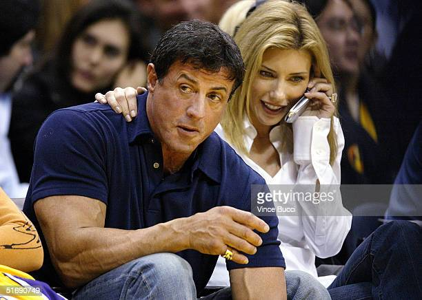Actor Sylvester Stallone and wife Jennifer Flavin attend the game between the Los Angeles Lakers and the San Antonio Spurs at the Staples Center on...