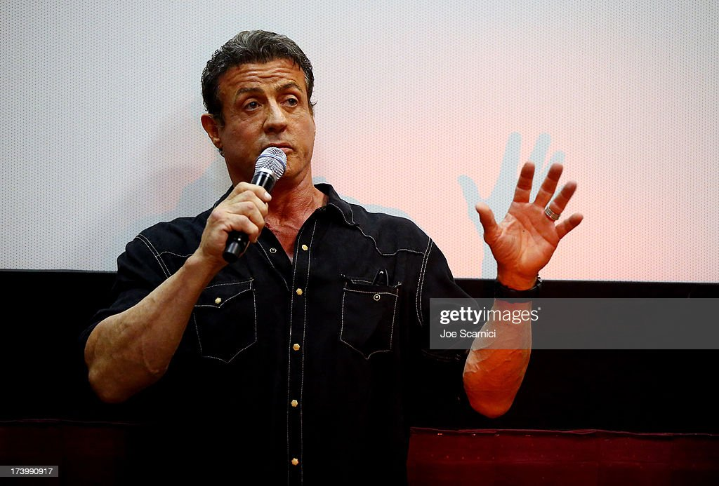 Actor <a gi-track='captionPersonalityLinkClicked' href=/galleries/search?phrase=Sylvester+Stallone&family=editorial&specificpeople=202604 ng-click='$event.stopPropagation()'>Sylvester Stallone</a> attends the 'Escape Plan' screening and red carpet during Comic-Con International 2013 at Reading Cinemas Gaslamp on July 18, 2013 in San Diego, California.