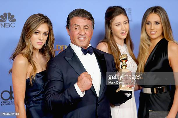 Actor Sylvester Stallone winner of Best Supporting Performance in a Motion Picture for 'Creed' poses in the press room with daughters Sistine Sophia...