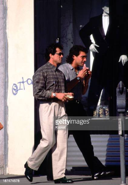 Actor Sylvester Stallone with a friend walking along Melrose Avenue Los Angeles California circa 1985