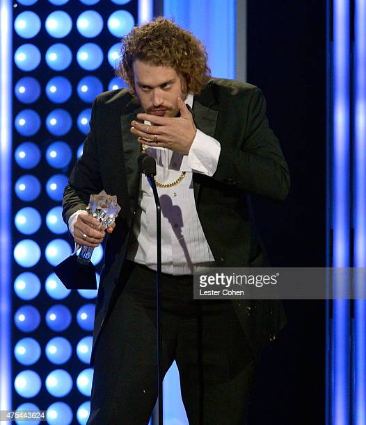 Actor T J Miller chews on food while accepting the Best Supporting Actor award for 'Silicon Valley' onstage at the 5th Annual Critics' Choice...