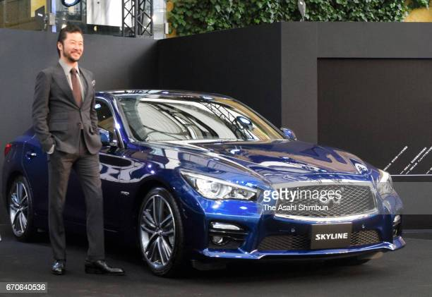 Actor Tadanobu Asano poses for photographs with Nissan Motor Co's 'Skyline' latest edition '350T Hybrid Type SP 60th Limited' during the 'Skyline...