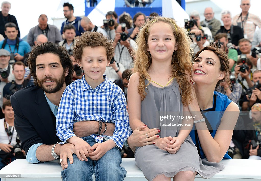 Actor <a gi-track='captionPersonalityLinkClicked' href=/galleries/search?phrase=Tahar+Rahim&family=editorial&specificpeople=5856944 ng-click='$event.stopPropagation()'>Tahar Rahim</a>, actor Elyes Aguis, actress Jeanne Jestin and actress Berenice Bejo attend 'Le Passe' photocall during the 66th Annual Cannes Film Festival at the Palais des Festivals on May 17, 2013 in Cannes, France.