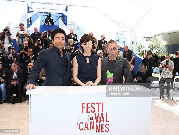 Actor Takao Osawa actress Nanako Matsushima and Director Takashi Miike attend the photocall for 'Wara No Tate' at The 66th Annual Cannes Film...