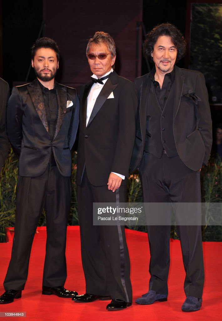 Actor Takayuki Yamada, director <a gi-track='captionPersonalityLinkClicked' href=/galleries/search?phrase=Takashi+Miike&family=editorial&specificpeople=822402 ng-click='$event.stopPropagation()'>Takashi Miike</a> and actor <a gi-track='captionPersonalityLinkClicked' href=/galleries/search?phrase=Koji+Yakusho&family=editorial&specificpeople=616781 ng-click='$event.stopPropagation()'>Koji Yakusho</a> attends the '13 Assassins' Premiere during the 67th Venice Film Festival at the Sala Grande Palazzo Del Cinema on September 9, 2010 in Venice, Italy.