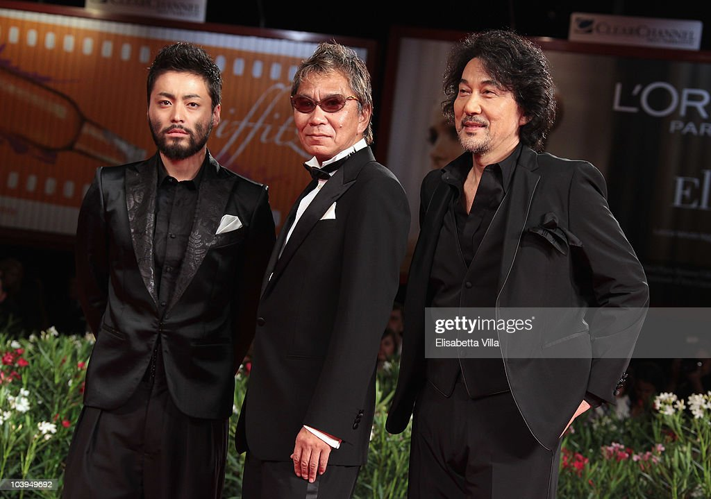 Actor Takayuki Yamada, director <a gi-track='captionPersonalityLinkClicked' href=/galleries/search?phrase=Takashi+Miike&family=editorial&specificpeople=822402 ng-click='$event.stopPropagation()'>Takashi Miike</a> and actor <a gi-track='captionPersonalityLinkClicked' href=/galleries/search?phrase=Koji+Yakusho&family=editorial&specificpeople=616781 ng-click='$event.stopPropagation()'>Koji Yakusho</a> attend the '13 Assassins' (Jusan-Nin No Shikaku) premiere during the 67th Venice Film Festival at the Sala Grande Palazzo Del Cinema on September 9, 2010 in Venice, Italy.