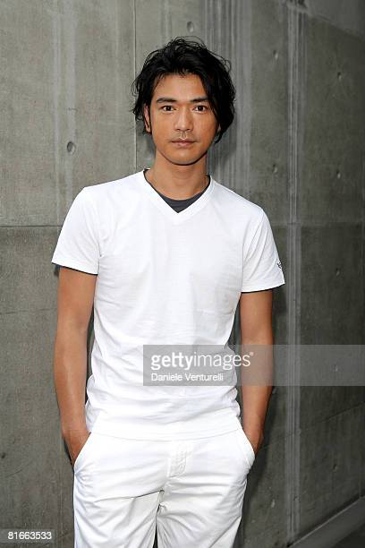 Actor Takeshi Kaneshiro arrives at the Emporio Armani fashion show as part of Milan Fashion Week Spring/Summer 2009 on June 22 2008 in Milan Italy