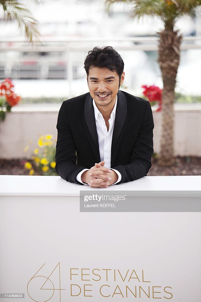 Actor <a gi-track='captionPersonalityLinkClicked' href=/galleries/search?phrase=Takeshi+Kaneshiro&family=editorial&specificpeople=171924 ng-click='$event.stopPropagation()'>Takeshi Kaneshiro</a> attends the 'Wu Xia' Photocall at the Palais des Festivals during the 64th Cannes Film Festival on May 14, 2011 in Cannes, France.