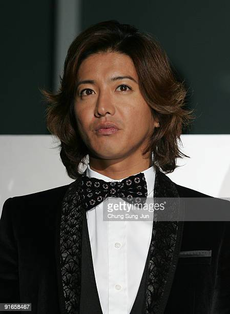 Actor Takuya Kimura attends at the photocall for the Gala Presentation 'I Come with the Rain' during the 14th Pusan International Film Festival at...