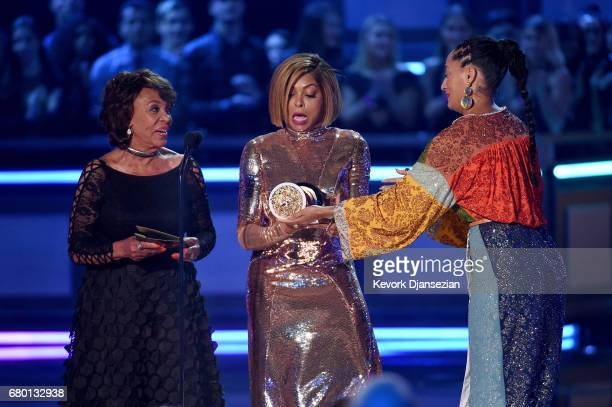 Actor Taraji P Henson accepts the Best Fight Against The System award for 'Hidden Figures' from US Representative Maxine Waters and actor Tracee...