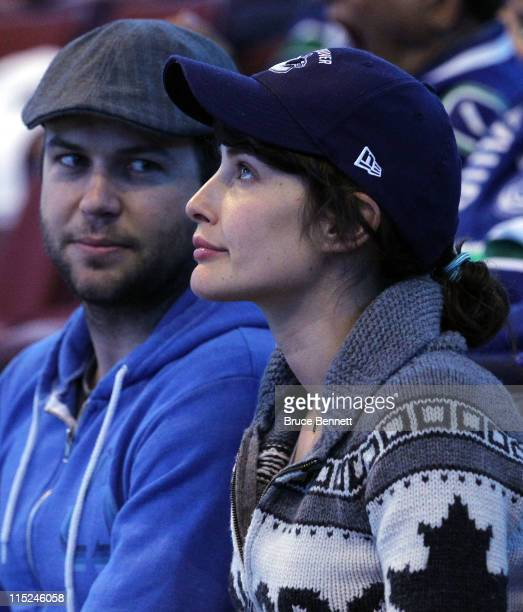 Actor Taran Killam and actress Cobie Smulders watch Game Two between the Vancouver Canucks and the Boston Bruins in the 2011 NHL Stanley Cup Final at...