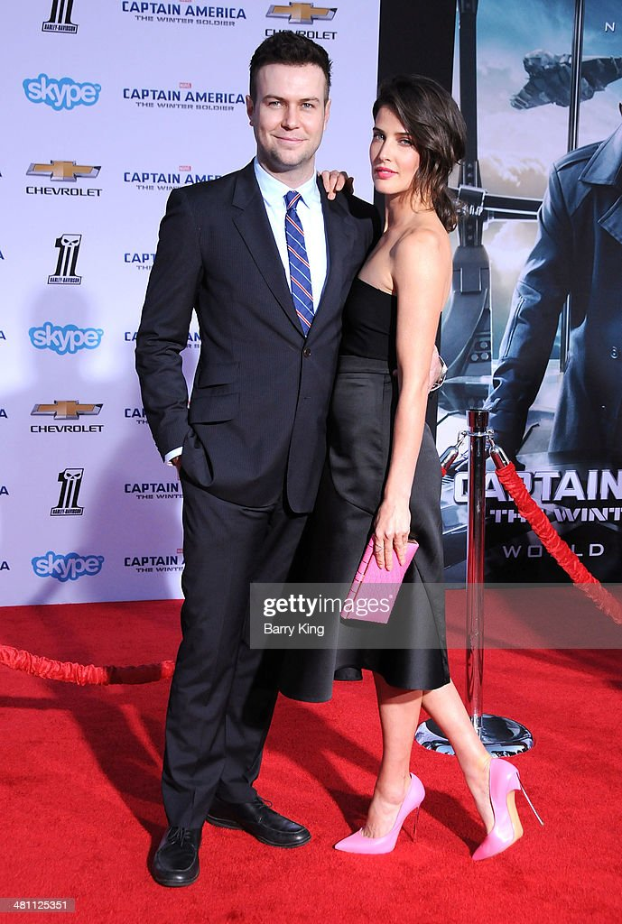 Actor Taran Killam (L) and wife actress Cobie Smulders arrive at the Los Angeles premiere of 'Captain America: The Winter Soldier' on March 13, 2014 at the El Capitan Theatre in Hollywood, California.