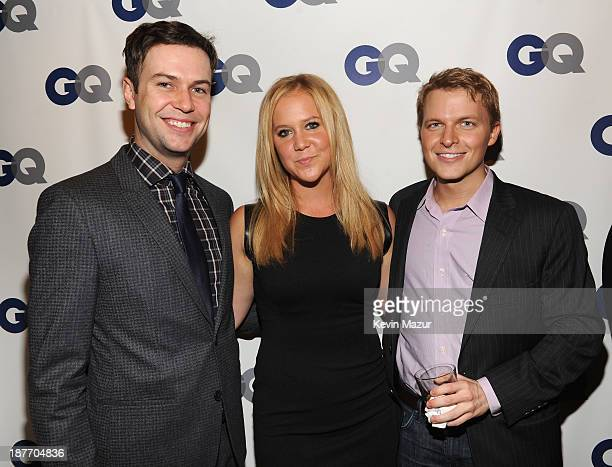 Actor Taran Killam comedian Amy Schumer and Ronan Farrow attend the GQ Men of the Year dinner on November 11 2013 in New York City