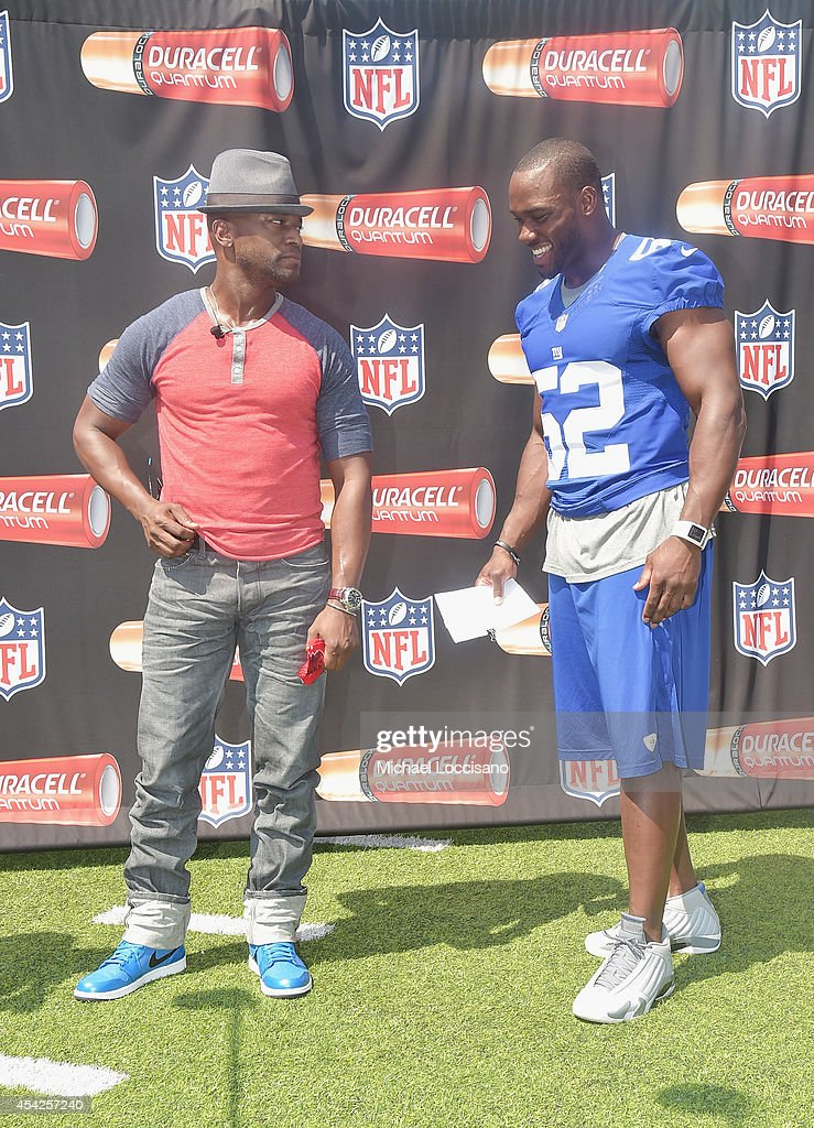 Actor Taye Diggs and professional football player Jon Beason attend an interactive tour of MetLife Stadium on August 27 2014 in East Rutherford New...