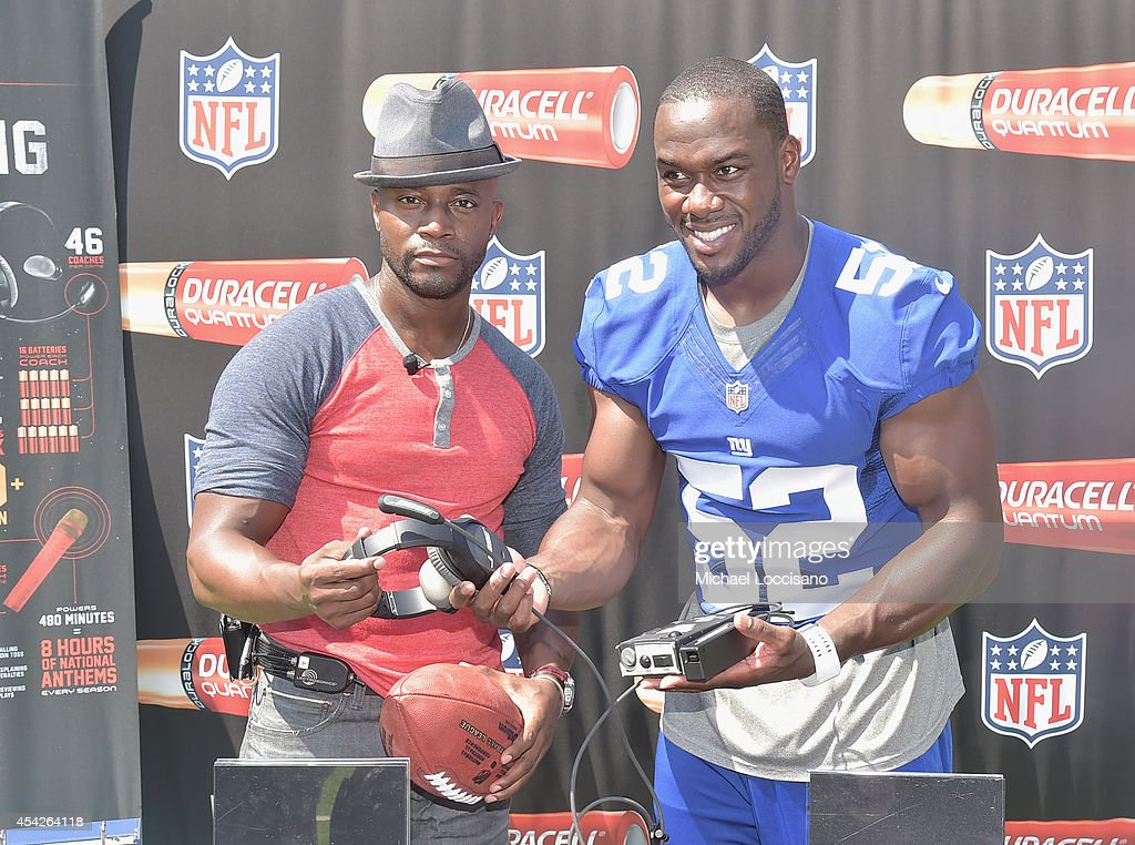Actor Taye Diggs (L) and professional football player Jon Beason attend an interactive tour of MetLife Stadium on August 27, 2014 in East Rutherford, New Jersey.