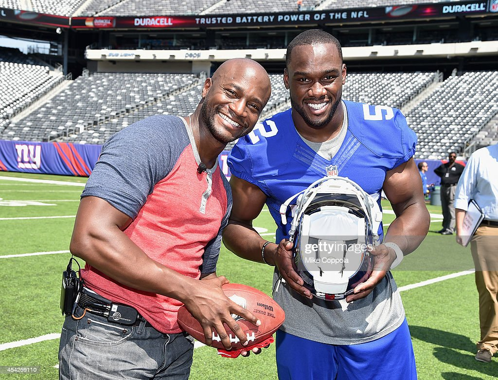 Actor Taye Diggs (L) and professional football player Jonathan Beason attend a Duracell interactive tour of MetLife Stadium on August 27, 2014 in East Rutherford, New Jersey.