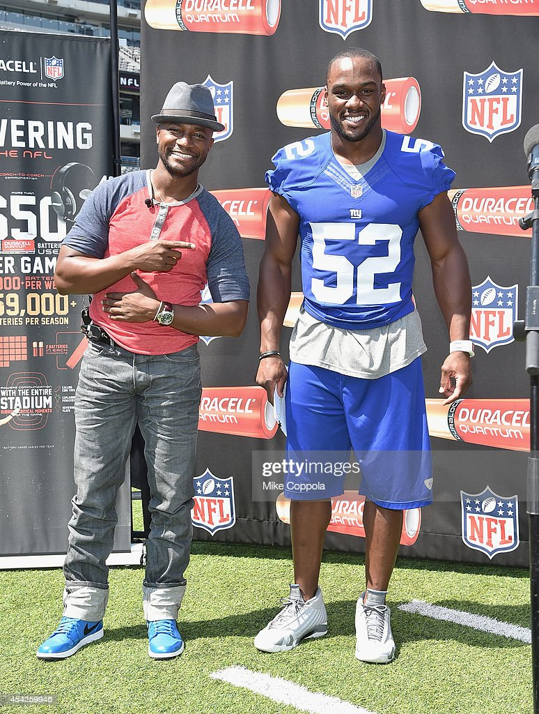 Actor Taye Diggs and professional football player Jonathan Beason attend a Duracell interactive tour of MetLife Stadium on August 27 2014 in East...