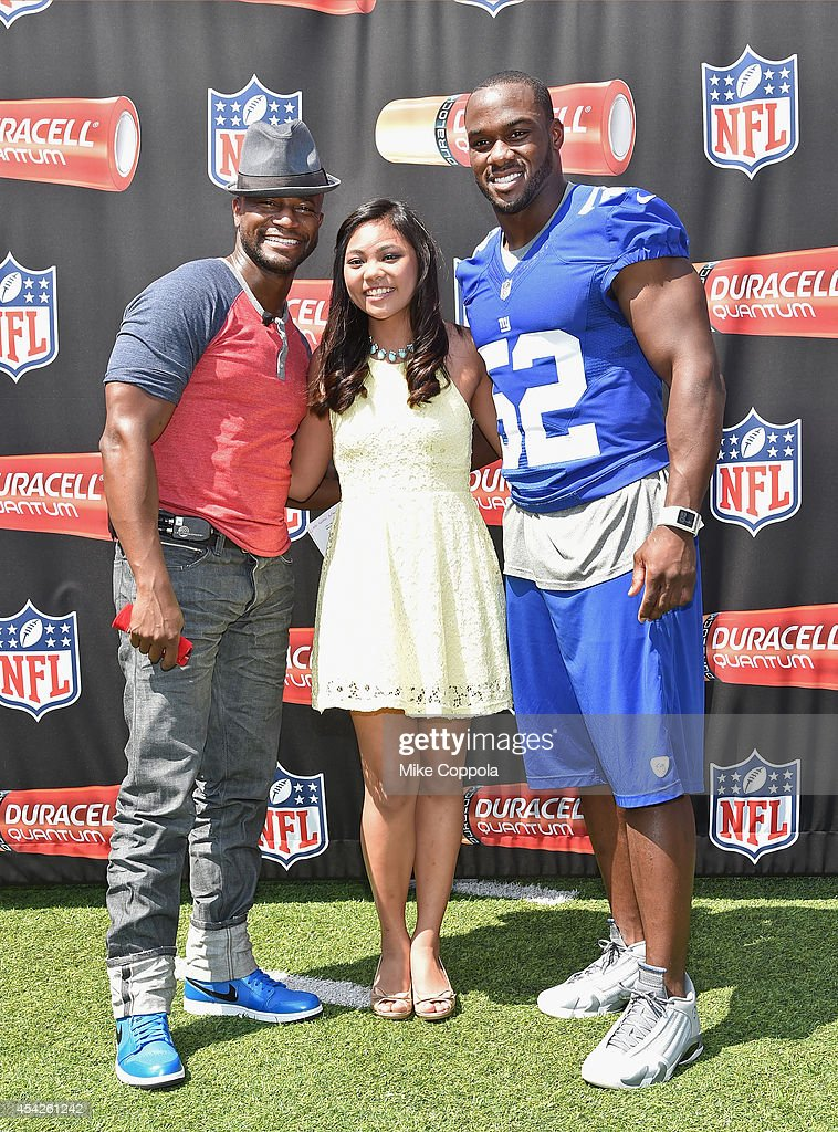 Actor Taye Diggs singer Singer Lianah Sta Ana and professional football player Jonathan Beason pose for a picture during the Duracell interactive...