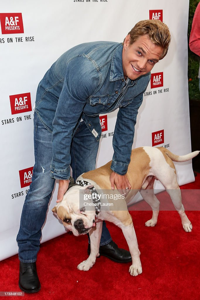 Actor Taylor Handley and actor dog Popeye attend Abercrombie & Fitch's 'Stars on the Rise' event at Abercrombie & Fitch on July 11, 2013 in Los Angeles, California.