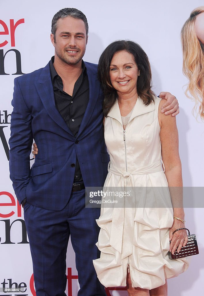 Actor <a gi-track='captionPersonalityLinkClicked' href=/galleries/search?phrase=Taylor+Kinney&family=editorial&specificpeople=747018 ng-click='$event.stopPropagation()'>Taylor Kinney</a> and mom Pamela Heisler arrive at the Los Angeles premiere of 'The Other Woman' at Regency Village Theatre on April 21, 2014 in Westwood, California.
