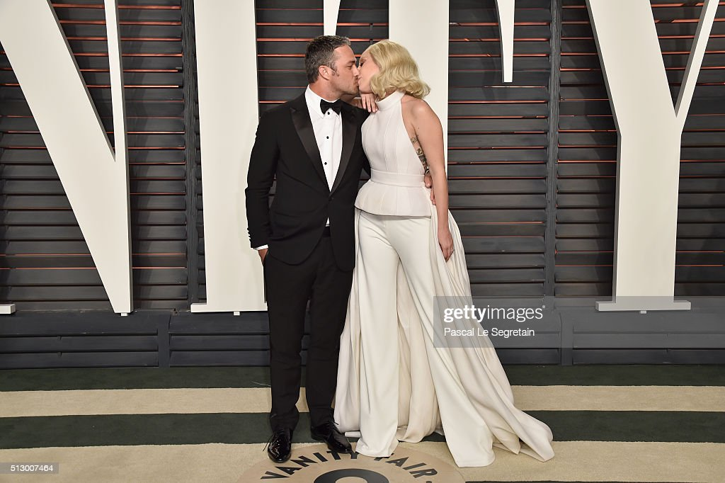 Actor Taylor Kinney and recording artist Lady Gaga attend the 2016 Vanity Fair Oscar Party Hosted By Graydon Carter at the Wallis Annenberg Center...