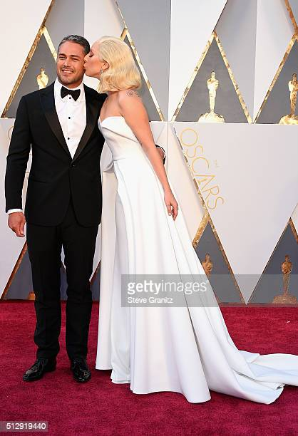 Actor Taylor Kinney and recording artist Lady Gaga attend the 88th Annual Academy Awards at Hollywood Highland Center on February 28 2016 in...