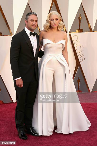 Actor Taylor Kinney and singer Lady Gaga attend the 88th Annual Academy Awards at Hollywood Highland Center on February 28 2016 in Hollywood...