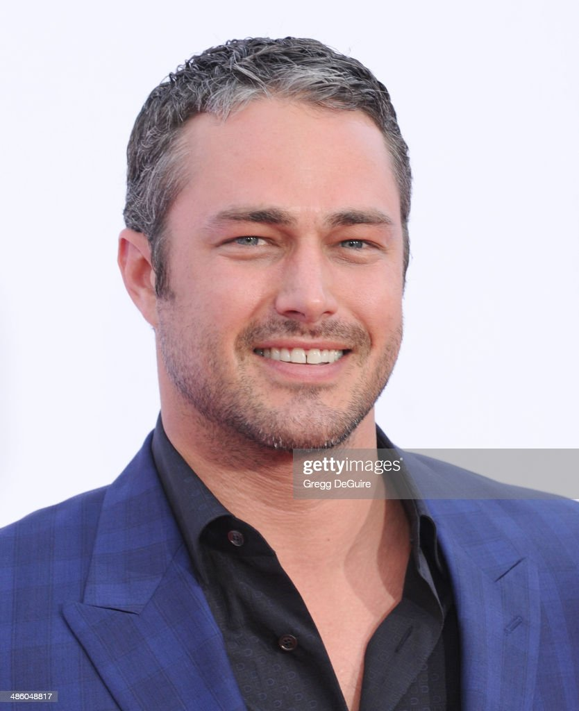 Actor <a gi-track='captionPersonalityLinkClicked' href=/galleries/search?phrase=Taylor+Kinney&family=editorial&specificpeople=747018 ng-click='$event.stopPropagation()'>Taylor Kinney</a> arrives at the Los Angeles premiere of 'The Other Woman' at Regency Village Theatre on April 21, 2014 in Westwood, California.