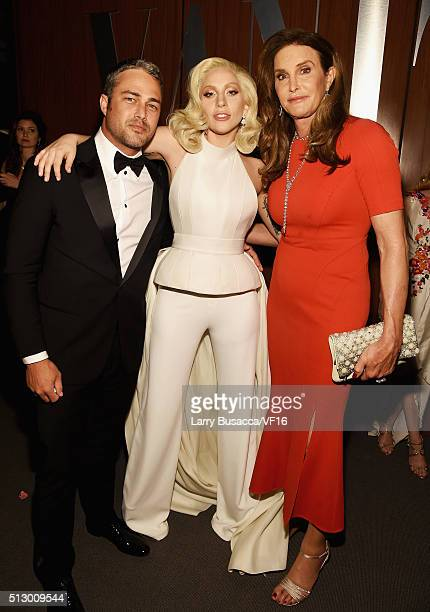 Actor Taylor Kinney recording artist/actress Lady Gaga and TV personality Caitlyn Jenner attend the 2016 Vanity Fair Oscar Party Hosted By Graydon...