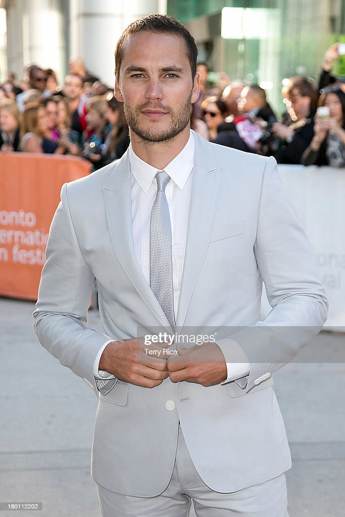 Actor <a gi-track='captionPersonalityLinkClicked' href=/galleries/search?phrase=Taylor+Kitsch&family=editorial&specificpeople=745008 ng-click='$event.stopPropagation()'>Taylor Kitsch</a> attends 'The Grand Seduction' premiere during the 2013 Toronto International Film Festival at Roy Thomson Hall on September 8, 2013 in Toronto, Canada.