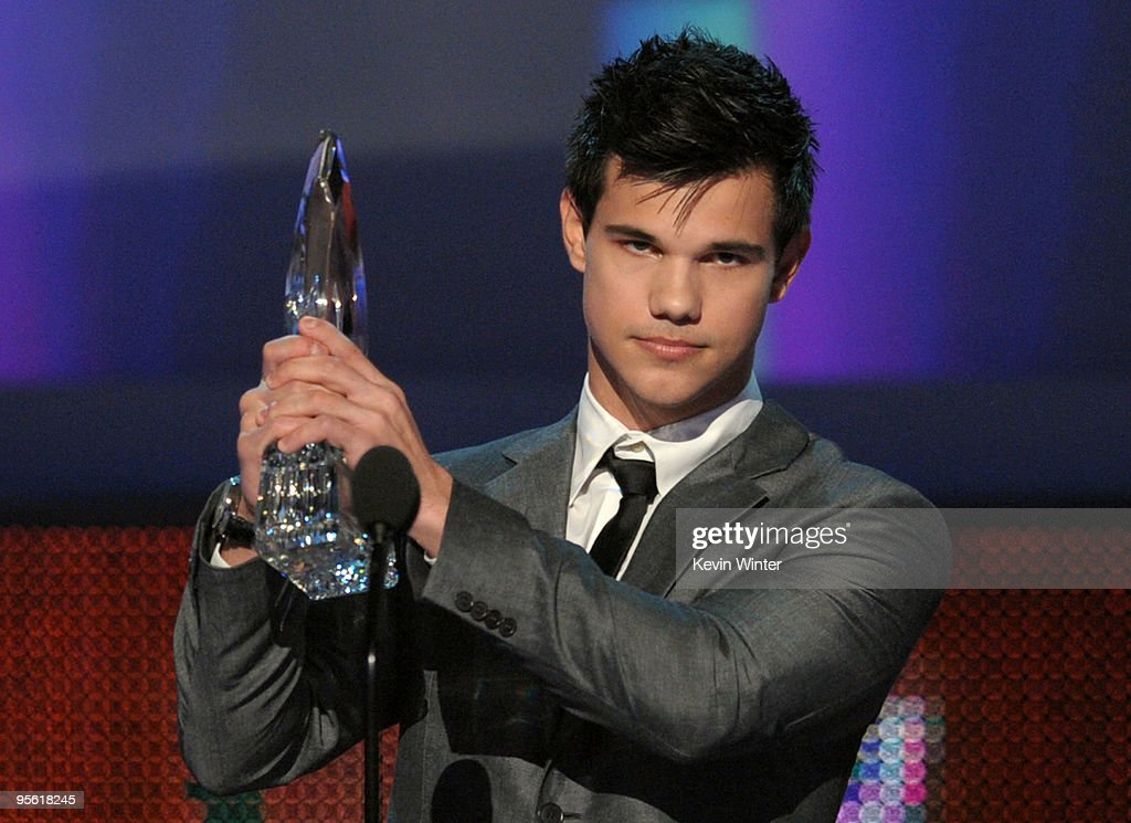 Actor Taylor Lautner accepts the award for Favorite Breakout Movie Actor onstage during the People's Choice Awards 2010 held at Nokia Theatre LA Live...