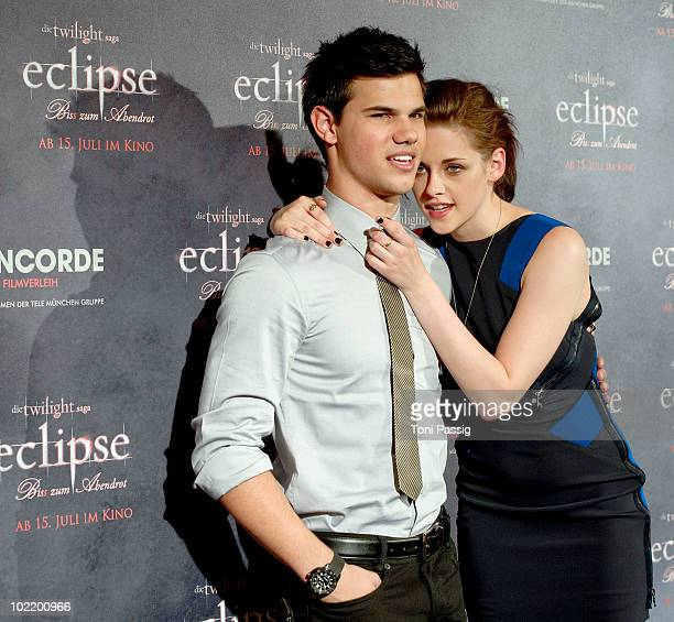 Actor Taylor Lautner and actress Kristen Stewart attend the German Photocall of 'The Twilight Saga Eclipse' at The Regent Berlin Hotel on June 18...