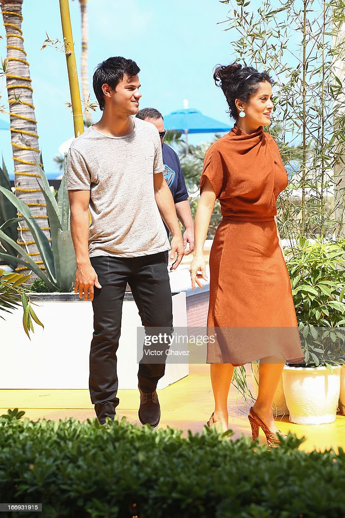 Actor Taylor Lautner and actress Salma Hayek attend the 'Grown Ups 2' photocall during The 5th Annual Summer Of Sony on April 18, 2013 in Cancun, Mexico.