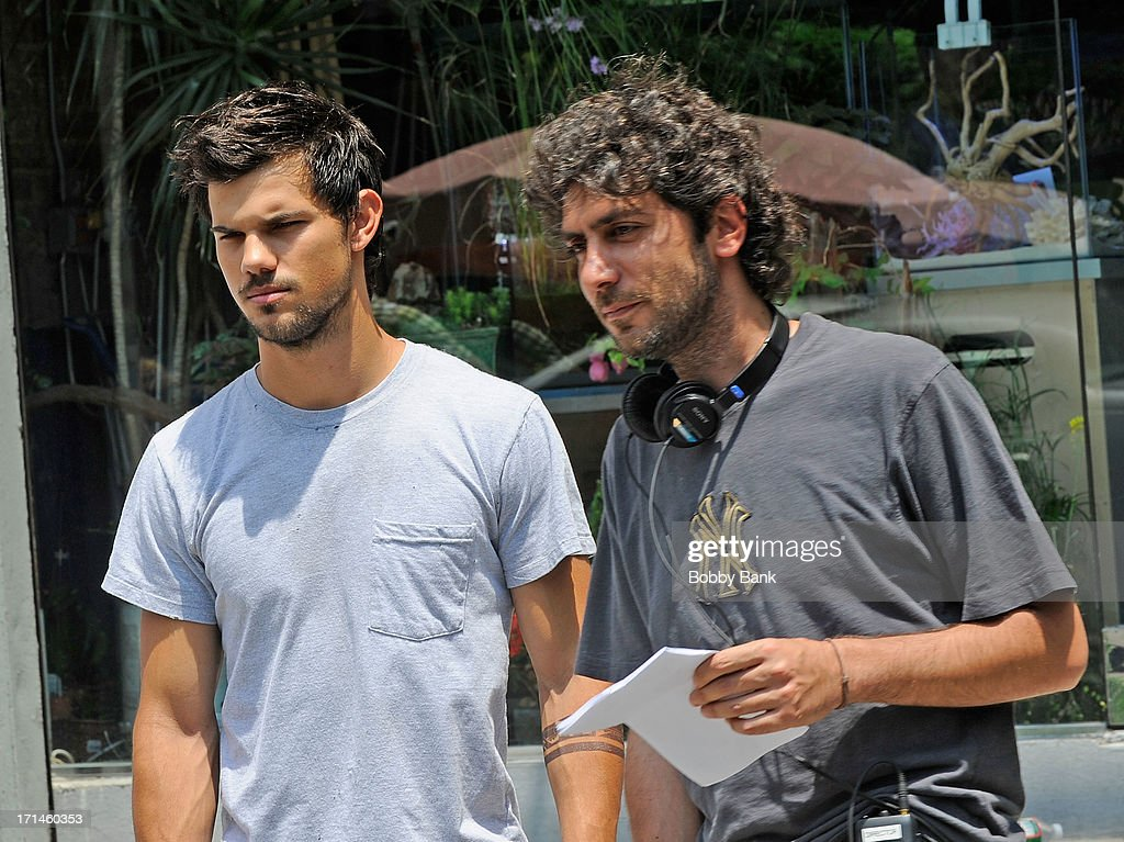 Actor Taylor Lautner and director Daniel Benmayor on the set of 'Tracers' on June 24, 2013 in New York City.