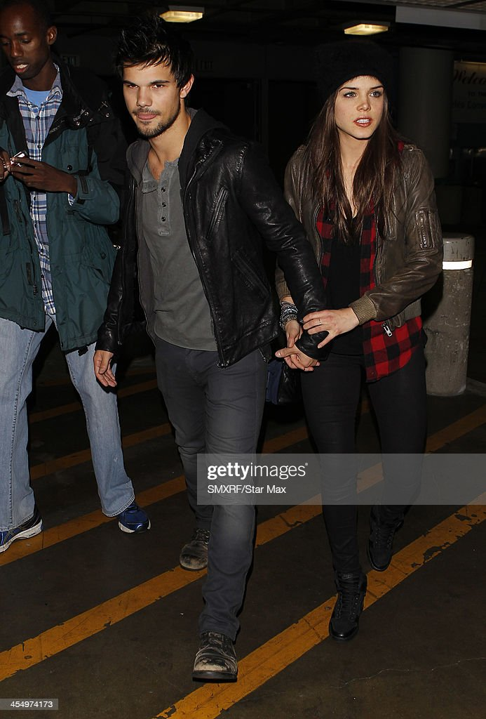 Actor <a gi-track='captionPersonalityLinkClicked' href=/galleries/search?phrase=Taylor+Lautner&family=editorial&specificpeople=228959 ng-click='$event.stopPropagation()'>Taylor Lautner</a> and <a gi-track='captionPersonalityLinkClicked' href=/galleries/search?phrase=Marie+Avgeropoulos&family=editorial&specificpeople=6709928 ng-click='$event.stopPropagation()'>Marie Avgeropoulos</a> are seen on December 09, 2013 in Los Angeles, California.