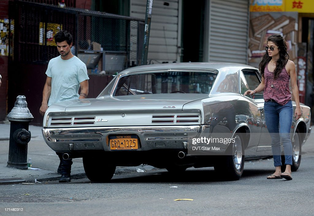 Actor Taylor Lautner and Marie Avgeropoulos is seen filming on June 24, 2013 in New York City.