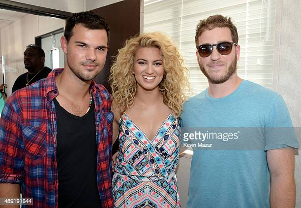 Actor Taylor Lautner and Tori Kelly attend The Daytime Village during the 2015 iHeartRadio Music Festival at the Las Vegas Village on September 19...