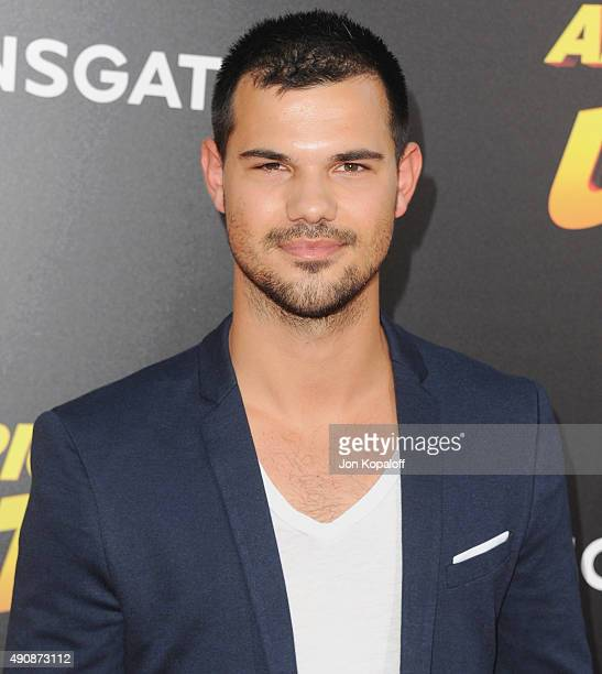 Actor Taylor Lautner arrives at the Los Angeles Premiere 'American Ultra' at Ace Theater Downtown LA on August 18 2015 in Los Angeles California
