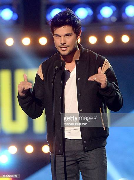 Actor Taylor Lautner speaks onstage during Cartoon Network's fourth annual Hall of Game Awards at Barker Hangar on February 15 2014 in Santa Monica...