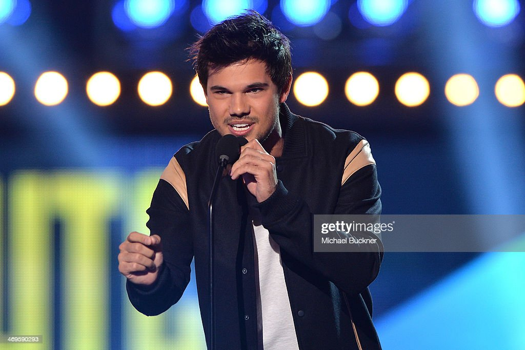 Actor Taylor Lautner speaks onstage during Cartoon Network's fourth annual Hall of Game Awards at Barker Hangar on February 15, 2014 in Santa Monica, California.