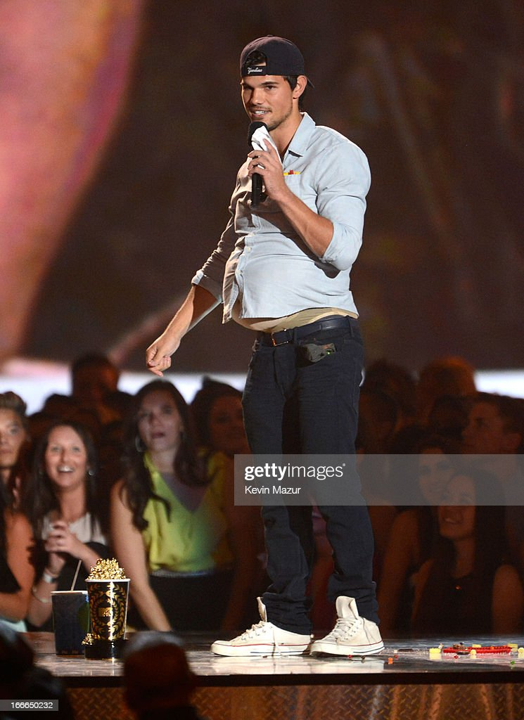 Actor Taylor Lautner speaks onstage during the 2013 MTV Movie Awards at Sony Pictures Studios on April 14, 2013 in Culver City, California.
