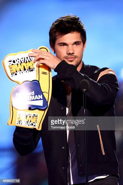 Actor Taylor Lautner speaks onstage during the 4th Annual Cartoon Network Hall Of Game Awards held at the Barker Hangar on February 15 2014 in Santa...