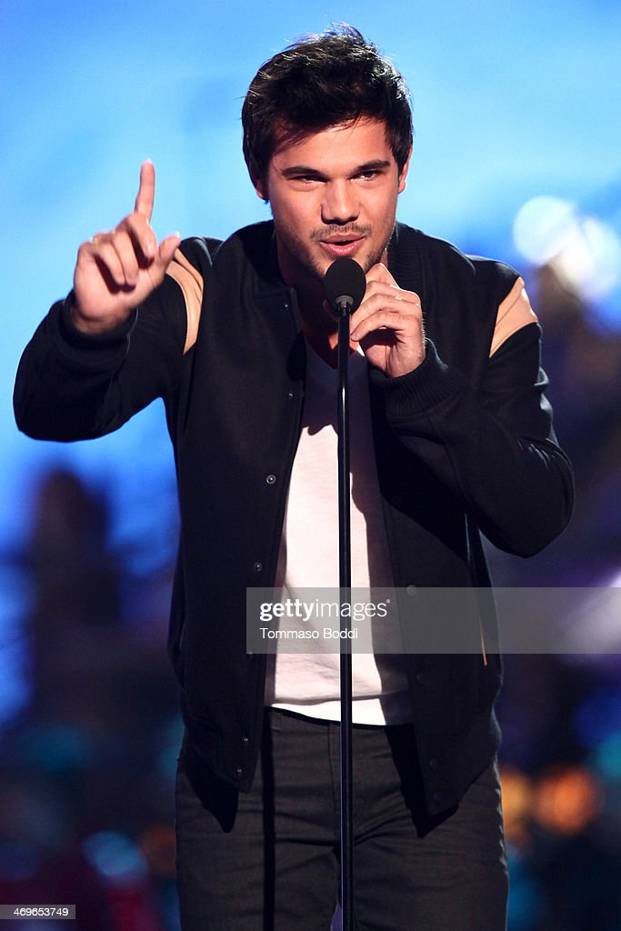 Actor Taylor Lautner speaks onstage during the 4th Annual Cartoon Network Hall Of Game Awards held at the Barker Hangar on February 15, 2014 in Santa Monica, California.